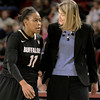 "University of Colorado head coach Linda Lappe talks with Brittany Wilson on the sideline during a games against the University of Denver on Tuesday, Dec. 11, at the Magnus Arena on the DU campus in Denver. For more photos of the game go to  <a href=""http://www.dailycamera.com"">http://www.dailycamera.com</a><br /> Jeremy Papasso/ Camera"
