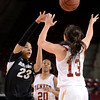 "University of Colorado's Chucky Jeffery passes the ball over the hands of Emiko Smith during a games against the University of Denver on Tuesday, Dec. 11, at the Magnus Arena on the DU campus in Denver. For more photos of the game go to  <a href=""http://www.dailycamera.com"">http://www.dailycamera.com</a><br /> Jeremy Papasso/ Camera"