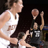 "University of Colorado's Chucky Jeffery takes a shot over a defender during a games against the University of Denver on Tuesday, Dec. 11, at the Magnus Arena on the DU campus in Denver. For more photos of the game go to  <a href=""http://www.dailycamera.com"">http://www.dailycamera.com</a><br /> Jeremy Papasso/ Camera"