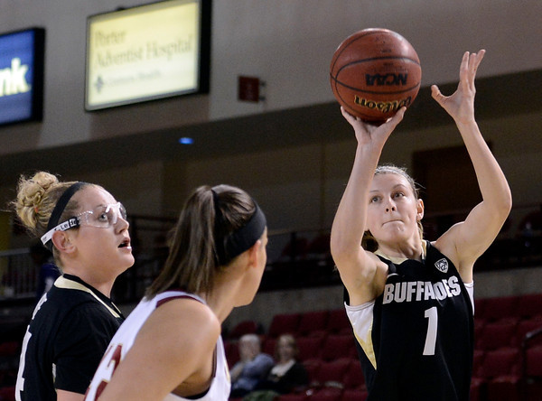 """University of Colorado's Lexy Kresl shoots a three-pointer in front of Alison Janecek during a games against the University of Denver on Tuesday, Dec. 11, at the Magnus Arena on the DU campus in Denver. For more photos of the game go to  <a href=""""http://www.dailycamera.com"""">http://www.dailycamera.com</a><br /> Jeremy Papasso/ Camera"""