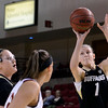 "University of Colorado's Lexy Kresl shoots a three-pointer in front of Alison Janecek during a games against the University of Denver on Tuesday, Dec. 11, at the Magnus Arena on the DU campus in Denver. For more photos of the game go to  <a href=""http://www.dailycamera.com"">http://www.dailycamera.com</a><br /> Jeremy Papasso/ Camera"