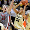 "Arielle Roberson of Colorado shoots over Sage Romberg of Washington State during the first half of the February 22nd, 2013 game in Boulder.<br /> For more photos of the game, go to  <a href=""http://www.dailycamera.com"">http://www.dailycamera.com</a>.<br /> Cliff Grassmick / February 22, 2013"
