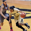 "Ashley Wilson of Colorado drives past Ireti Amojo of Washington State during the first half of the February 22nd, 2013 game in Boulder.<br /> For more photos of the game, go to  <a href=""http://www.dailycamera.com"">http://www.dailycamera.com</a>.<br /> Cliff Grassmick / February 22, 2013"