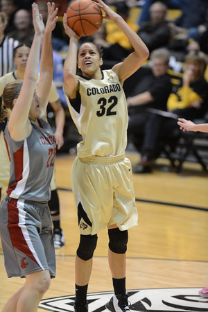 """Arielle Roberson shoots over Sage Romberg of WSU during the second half of the February 22nd, 2013 game in Boulder.<br /> For more photos of the game, go to  <a href=""""http://www.dailycamera.com"""">http://www.dailycamera.com</a>.<br /> Cliff Grassmick / February 22, 2013"""