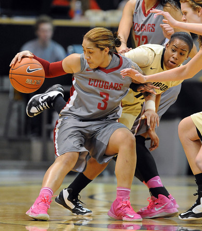 "Lia Galdeira, left, of Washington State, spins away from Brittany Wilson of Colorado during the first half of the February 22nd, 2013 game in Boulder.<br /> For more photos of the game, go to  <a href=""http://www.dailycamera.com"">http://www.dailycamera.com</a>.<br /> Cliff Grassmick / February 22, 2013"