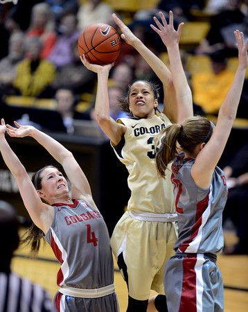 "Arielle Roberson of Colorado put up a shot on Katie Grad (4) of Washington State during the second half of the February 22nd, 2013 game in Boulder.<br /> For more photos of the game, go to  <a href=""http://www.dailycamera.com"">http://www.dailycamera.com</a>.<br /> Cliff Grassmick / February 22, 2013"