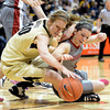 "Rachel Hargis, left, of Colorado, and Katie Grad of Washington State go to the floor for a loose ball during the first half of the February 22nd, 2013 game in Boulder.<br /> For more photos of the game, go to  <a href=""http://www.dailycamera.com"">http://www.dailycamera.com</a>.<br /> Cliff Grassmick / February 22, 2013"