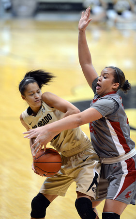 """Arielle Roberson of CU tries to keep Mariah Cooks of WSU away during the second half of the February 22nd, 2013 game in Boulder.<br /> For more photos of the game, go to  <a href=""""http://www.dailycamera.com"""">http://www.dailycamera.com</a>.<br /> Cliff Grassmick / February 22, 2013"""