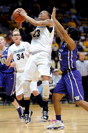 "Chucky Jeffery of CU goes up for a shot past Jazmine Davis of Washington during the first half of the Feb. 24th, 2013 game in Boulder, Colorado.<br /> For more photos of the game, go to  <a href=""http://www.dailycamera.com"">http://www.dailycamera.com</a>.<br /> Cliff Grassmick / February 24, 2013"