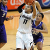 "Brittany Wilson of CU shoots with Talia Walton (3) and Jazmine Davis, of washington, defending.<br /> For more photos of the game, go to  <a href=""http://www.dailycamera.com"">http://www.dailycamera.com</a>.<br /> Cliff Grassmick / February 24, 2013"