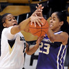 Ashley Wilson , left, of Colorado and Aminah Williams, of Washington, battle for possession during the first half of the February 24th, 2013 game in Boulder.<br /> Cliff Grassmick / February 24, 2013
