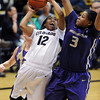 "Ashley Wilson of CU drives to the basket into Talia Walton of Washington.<br /> For more photos of the game, go to  <a href=""http://www.dailycamera.com"">http://www.dailycamera.com</a>.<br /> Cliff Grassmick / February 24, 2013"
