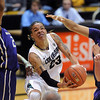 "Chucky Jeffery of CU goes between Aminah Williams, left, and Talia Walton  of Washington during the first half of the Feb. 24th, 2013 game in Boulder, Colorado.<br /> For more photos of the game, go to  <a href=""http://www.dailycamera.com"">http://www.dailycamera.com</a>.<br /> Cliff Grassmick / February 24, 2013"