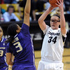 "Jen Reese of CU looks to pass over Talia Walton of Washington.<br /> For more photos of the game, go to  <a href=""http://www.dailycamera.com"">http://www.dailycamera.com</a>.<br /> Cliff Grassmick / February 24, 2013"