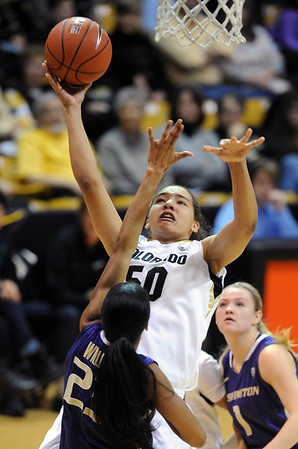 "Jamee Swan of Colorado shoots over Aminah Williams of Washington during the first half of the Feb. 24th, 2013 game in Boulder.<br /> For more photos of the game, go to  <a href=""http://www.dailycamera.com"">http://www.dailycamera.com</a>.<br /> Cliff Grassmick / February 24, 2013"