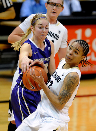 "Chucky Jeffery of CU spins away from Kristi Kingma of Washington.<br /> For more photos of the game, go to  <a href=""http://www.dailycamera.com"">http://www.dailycamera.com</a>.<br /> Cliff Grassmick / February 24, 2013"