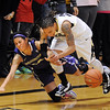 "Chucky Jeffery, right, of CU, tries to get the steal from Deborah Meeks of Washington.<br /> For more photos of the game, go to  <a href=""http://www.dailycamera.com"">http://www.dailycamera.com</a>.<br /> Cliff Grassmick / February 24, 2013"