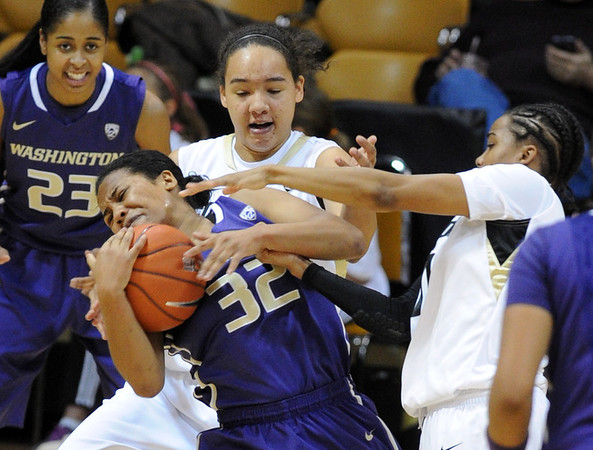 "Jazmine Davis (32) of Washington, rips the ball from Ashley Wilson, right, and Jamee Swan, back, both of Colorado, during the first half of the Feb.24th, 2013 game in Boulder.<br /> For more photos of the game, go to  <a href=""http://www.dailycamera.com"">http://www.dailycamera.com</a>.<br /> Cliff Grassmick / February 24, 2013"