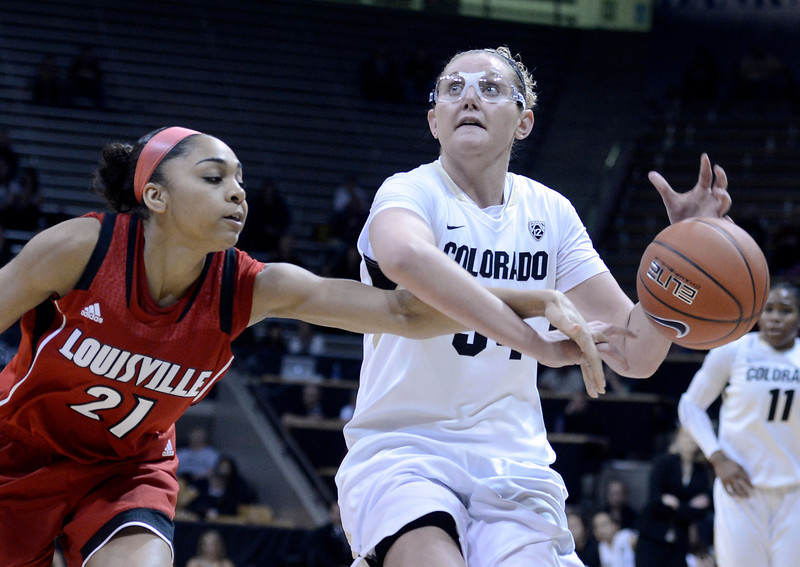 "University of Colorado's Jen Reese gets the ball knocked out of her hands by Bria Smith on Friday, Dec. 14, during a game against Louisville at the Coors Event Center on the CU campus in Boulder. For more photos of the game go to  <a href=""http://www.dailycamera.com"">http://www.dailycamera.com</a><br /> Jeremy Papasso/ Camera"