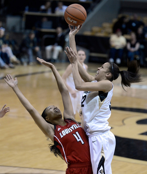 "University of Colorado's Arielle Roberson takes a shot over Antonita Slaughter on Friday, Dec. 14, during a game against Louisville at the Coors Event Center on the CU campus in Boulder. For more photos of the game go to  <a href=""http://www.dailycamera.com"">http://www.dailycamera.com</a><br /> Jeremy Papasso/ Camera"