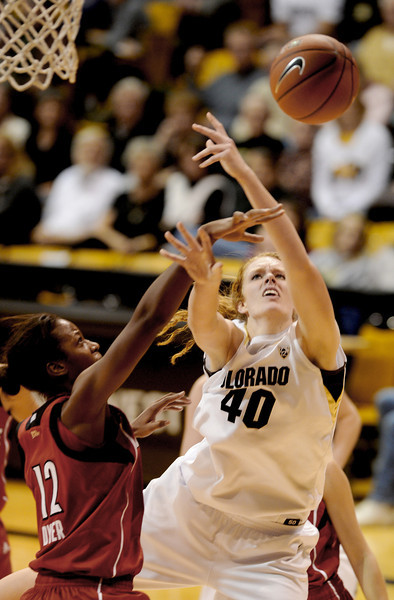 Rachel Hargis of CU is fouled by Shawnta' Dyer of Louisville.<br /> Cliff Grassmick / December 14, 2012