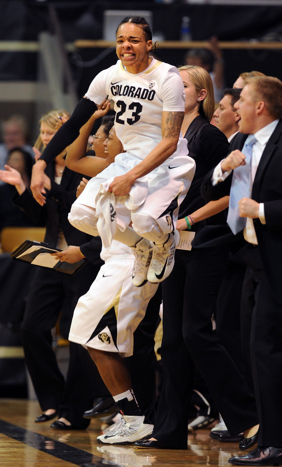 Chucky Jeffery of CU gets excited on the bench during the Louisville upset.<br /> Cliff Grassmick / December 14, 2012