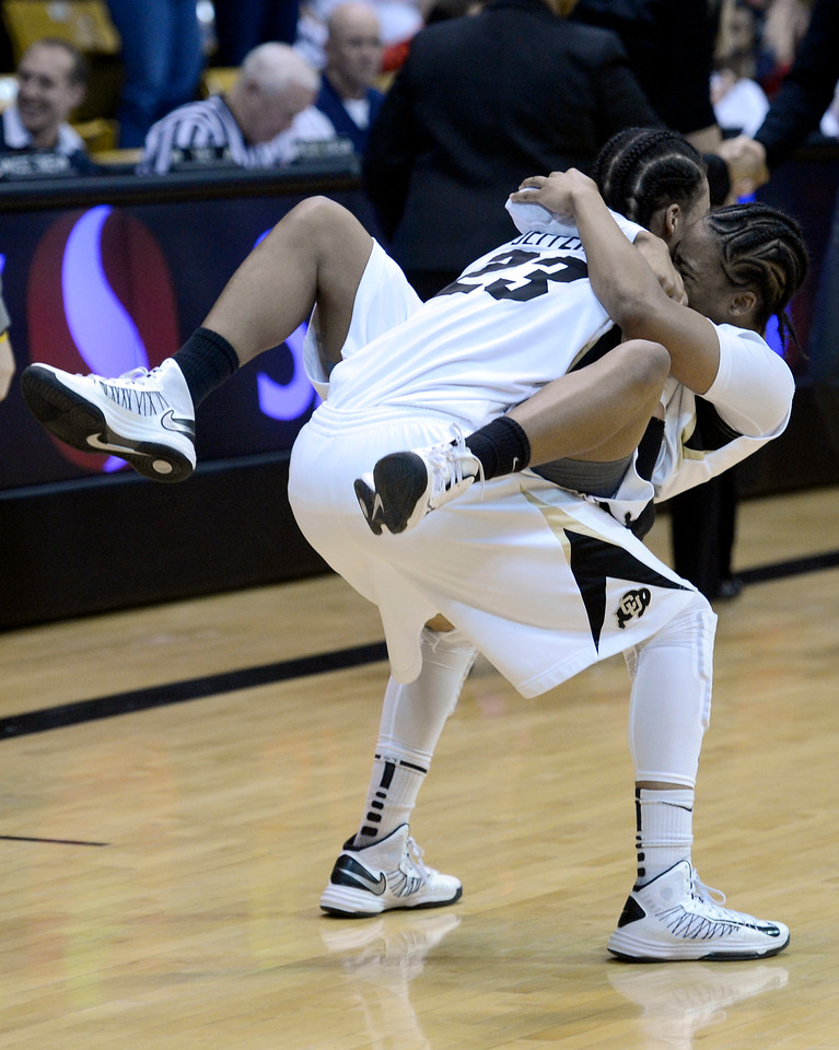 "University of Colorado's Brittany Wilson jumps into the arms of teammate Chucky Jeffery on Friday, Dec. 14, after defeating Louisville at the Coors Event Center on the CU campus in Boulder. For more photos of the game go to  <a href=""http://www.dailycamera.com"">http://www.dailycamera.com</a><br /> Jeremy Papasso/ Camera"