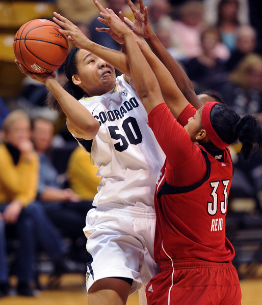 Jamee Swan of CU, goes up on Monique Reid of Louisville.<br /> Cliff Grassmick / December 14, 2012