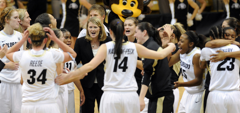 Coach Linda Lappe, center, celebrates with her team after they upset Louisville.<br /> Cliff Grassmick / December 14, 2012