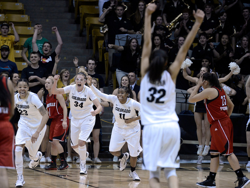 "University of Colorado's Chucky Jeffery, left, Jen Reese, Brittany Wilson and Arielle Roberson celebrate after defeating Louisville on Friday, Dec. 14, at the Coors Event Center on the CU campus in Boulder. For more photos of the game go to  <a href=""http://www.dailycamera.com"">http://www.dailycamera.com</a><br /> Jeremy Papasso/ Camera"