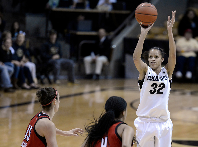 "University of Colorado's Arielle Roberson takes a shot over Meghan Dienes, No. 15, and Antonita Slaughter, No. 4, on Friday, Dec. 14, during a game against Louisville at the Coors Event Center on the CU campus in Boulder. For more photos of the game go to  <a href=""http://www.dailycamera.com"">http://www.dailycamera.com</a><br /> Jeremy Papasso/ Camera"