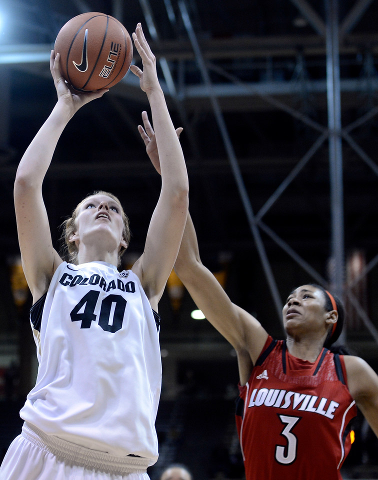 "University of Colorado's Rachel Hargis takes a shot over Sheronne Vails on Friday, Dec. 14, during a game against Louisville at the Coors Event Center on the CU campus in Boulder. For more photos of the game go to  <a href=""http://www.dailycamera.com"">http://www.dailycamera.com</a><br /> Jeremy Papasso/ Camera"