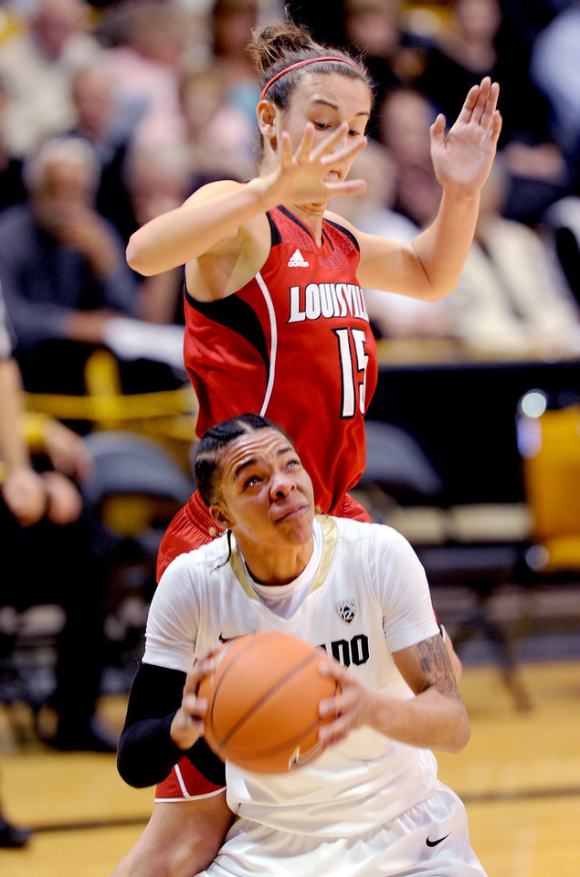 Chucky Jeffery of CU goes up on Megan Deines of Louisville.<br /> Cliff Grassmick / December 14, 2012