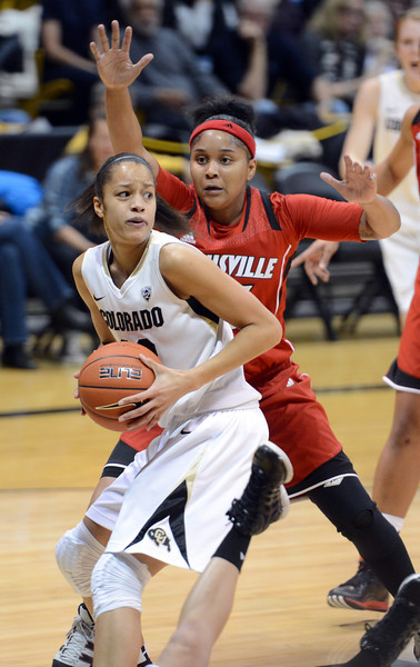 Arielle Roberson of CU looks to score on Monique Reid of Louisville.<br /> Cliff Grassmick / December 14, 2012