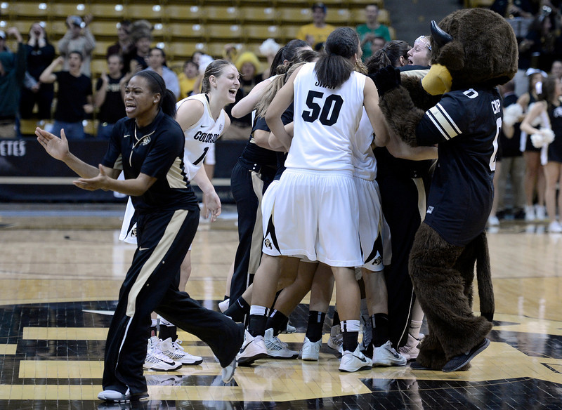 "The University of Colorado girls basketball team celebrates after defeating Louisville on Friday, Dec. 14, at the Coors Event Center on the CU campus in Boulder. For more photos of the game go to  <a href=""http://www.dailycamera.com"">http://www.dailycamera.com</a><br /> Jeremy Papasso/ Camera"
