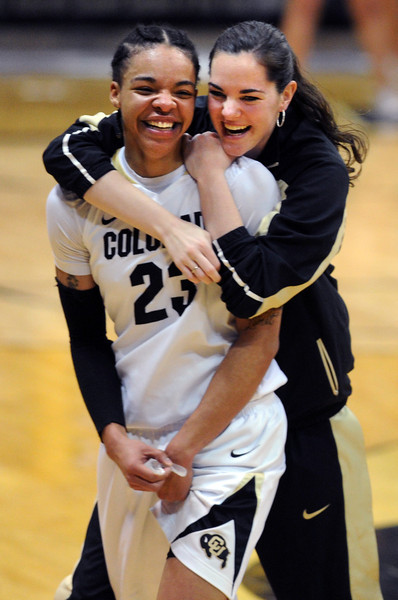 Chucky Jeffery, left, and Brenna Malcolm-Peck, celebrate the upset of Louisville.<br /> Cliff Grassmick / December 14, 2012