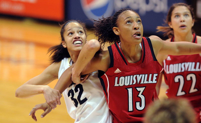 Arielle Roberson, left, of CU and Cortnee Walton of Louisville, battle for a rebound.<br /> Cliff Grassmick / December 14, 2012