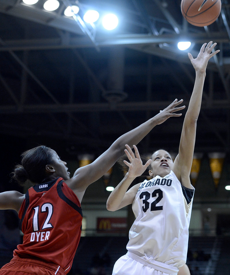 "University of Colorado's Arielle Roberson takes a shot over Shawnta Dyer on Friday, Dec. 14, during a game against Louisville at the Coors Event Center on the CU campus in Boulder. For more photos of the game go to  <a href=""http://www.dailycamera.com"">http://www.dailycamera.com</a><br /> Jeremy Papasso/ Camera"
