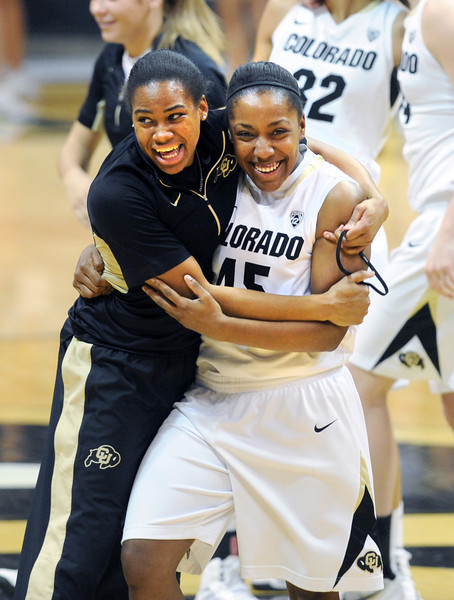 Ashley Wilson, left, and Kyleesha Weston, celebrate the upset of Louisville.<br /> Cliff Grassmick / December 14, 2012