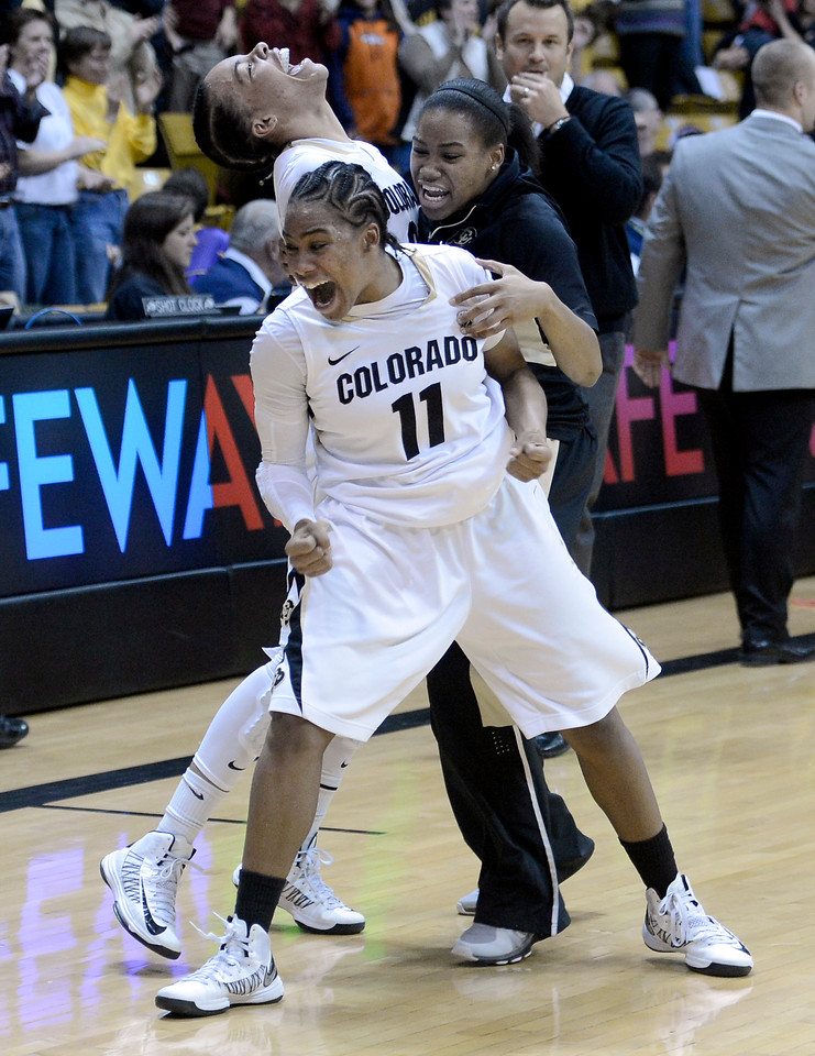 "University of Colorado's Brittany Wilson, front, Chucky Jeffery and Ashley Wilson celebrate together after defeating Louisville on Friday, Dec. 14,  at the Coors Event Center on the CU campus in Boulder. For more photos of the game go to  <a href=""http://www.dailycamera.com"">http://www.dailycamera.com</a><br /> Jeremy Papasso/ Camera"