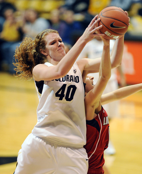 Rachel Hargis gets a rebound in the Louisville game.<br /> Cliff Grassmick / December 14, 2012
