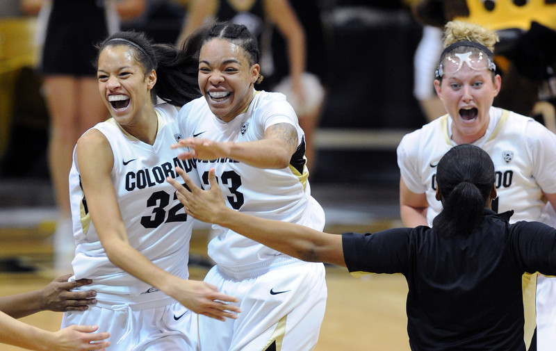 Chucky Jeffery, right,  of CU, is hugged by Arielle Roberson as the Buffs upset  #8  Louisville. Jen Reese celebrates on the right.<br /> Cliff Grassmick / December 14, 2012