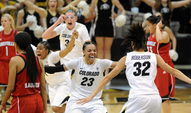Chucky Jeffery (23) of CU prepares to jump into the arms of Arielle Roberson as the Buffs upset #8  Louisville.<br /> Cliff Grassmick / December 14, 2012