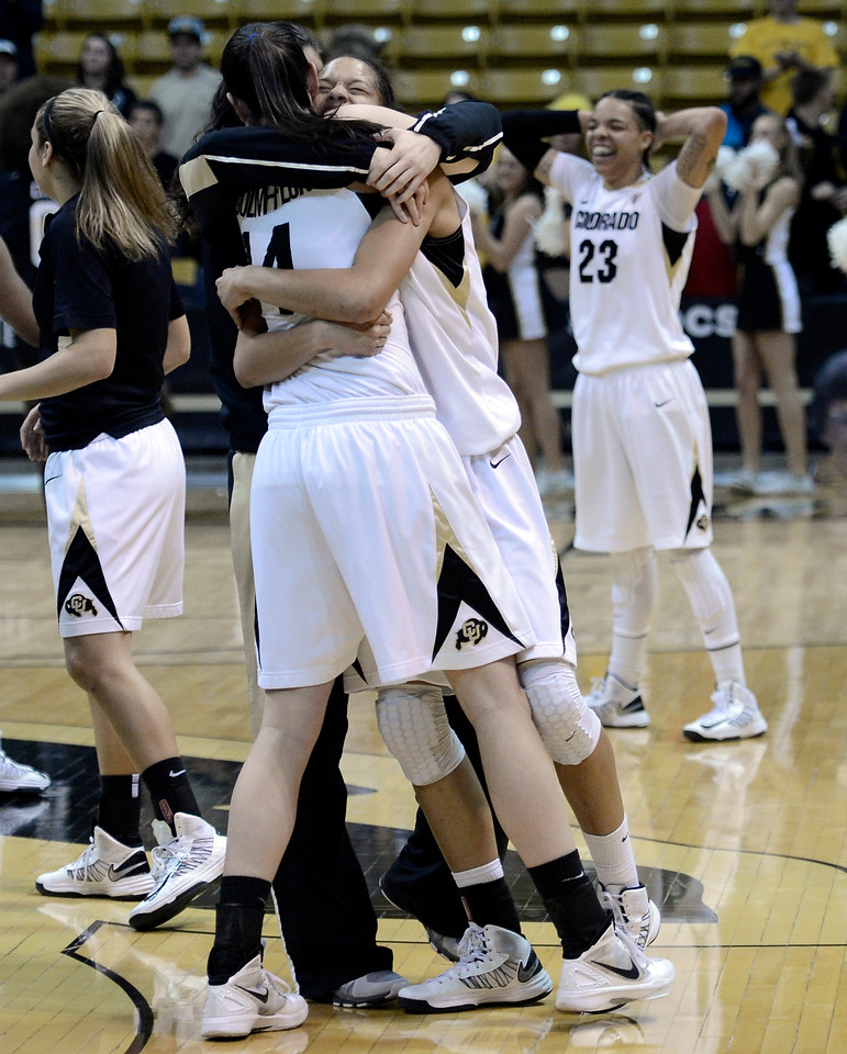 "University of Colorado's Arielle Roberson, middle, is hugged by Meagan Malcolm-Peck on Friday, Dec. 14, after defeating Louisville at the Coors Event Center on the CU campus in Boulder. For more photos of the game go to  <a href=""http://www.dailycamera.com"">http://www.dailycamera.com</a><br /> Jeremy Papasso/ Camera"