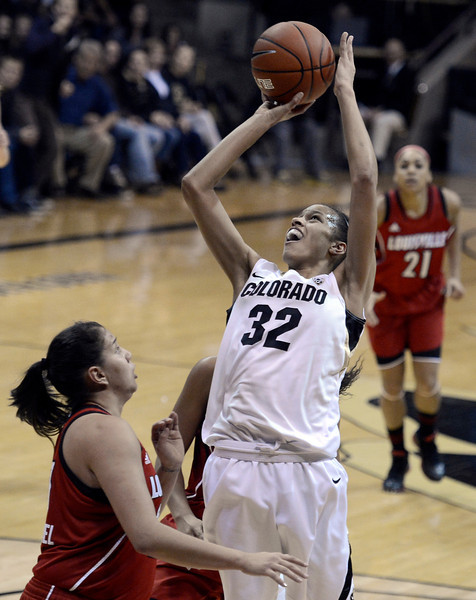 "University of Colorado's Arielle Roberson takes a shot over Shoni Schimmel on Friday, Dec. 14, during a game against Louisville at the Coors Event Center on the CU campus in Boulder. For more photos of the game go to  <a href=""http://www.dailycamera.com"">http://www.dailycamera.com</a><br /> Jeremy Papasso/ Camera"