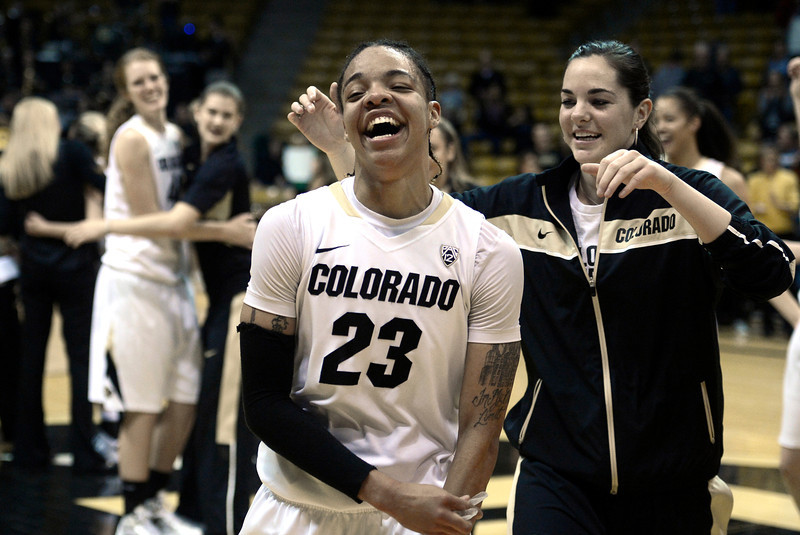 "University of Colorado's Chucky Jeffery smiles while celebrating with her team on Friday, Dec. 14, after defeating Louisville at the Coors Event Center on the CU campus in Boulder. For more photos of the game go to  <a href=""http://www.dailycamera.com"">http://www.dailycamera.com</a><br /> Jeremy Papasso/ Camera"