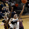 "University of Colorado's Chucky Jeffery goes for a layup over Micaela Pickens, left, during a game against Arizona State University on Friday, Jan. 18, at the Coors Event Center on the CU campus in Boulder. For more photos of the game go to  <a href=""http://www.dailycamera.com"">http://www.dailycamera.com</a><br /> Jeremy Papasso/ Camera"