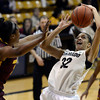 "University of Colorado's Arielle Roberson gets fouled by Janae Fulcher while going for a shot during a game against Arizona State University on Friday, Jan. 18, at the Coors Event Center on the CU campus in Boulder. For more photos of the game go to  <a href=""http://www.dailycamera.com"">http://www.dailycamera.com</a><br /> Jeremy Papasso/ Camera"