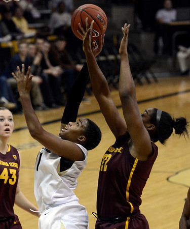 "University of Colorado's Brittany Wilson takes a shot over Janae Fulcher during a game against Arizona State University on Friday, Jan. 18, at the Coors Event Center on the CU campus in Boulder. For more photos of the game go to  <a href=""http://www.dailycamera.com"">http://www.dailycamera.com</a><br /> Jeremy Papasso/ Camera"