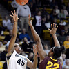 "University of Colorado's Kyleesha Weston takes a shot over Janae Fulcher during a game against Arizona State University on Friday, Jan. 18, at the Coors Event Center on the CU campus in Boulder. For more photos of the game go to  <a href=""http://www.dailycamera.com"">http://www.dailycamera.com</a><br /> Jeremy Papasso/ Camera"